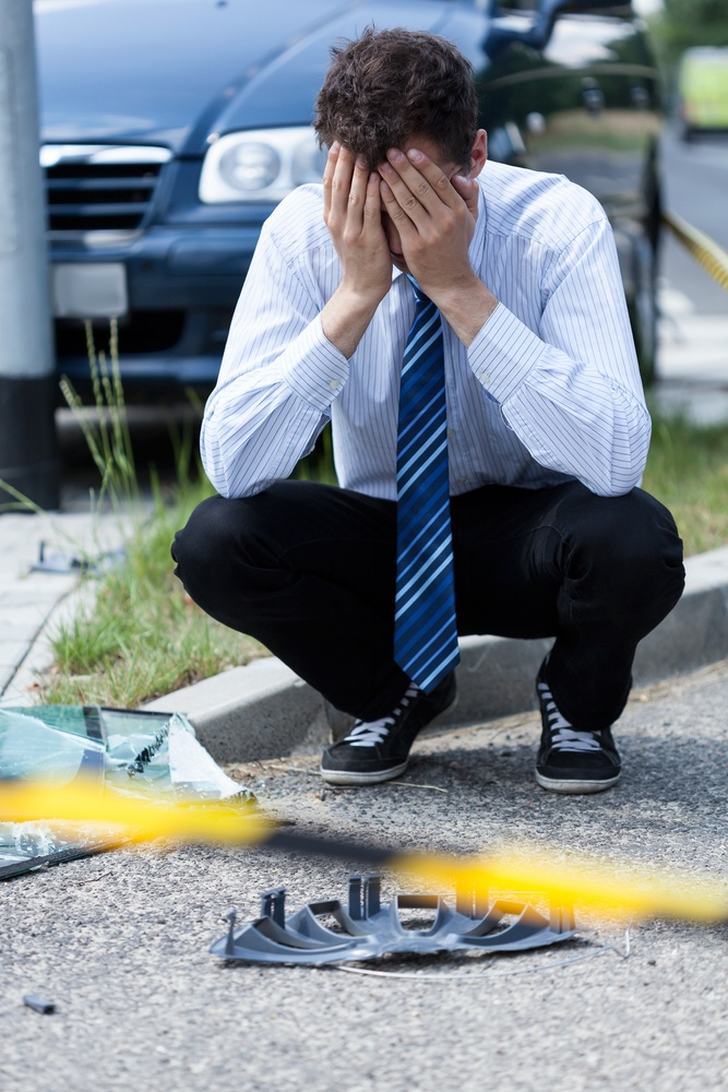 Elegant man crying at accident scene, vertical.jpeg
