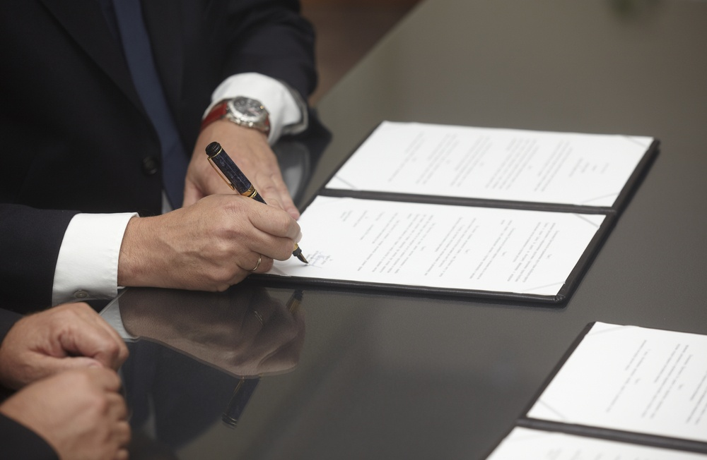 close up of businessman hands signing contract-1